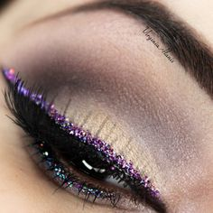 Well blended neutral lids are paired with a glittery liner. Recreate this gorgeous look for your next party with the help of IT Cosmetics amazing products.