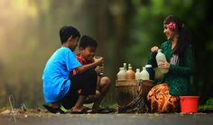Jamu Gendong, herbal drink in bottles, usually carried by women in traditional dress across regions.. on foot.