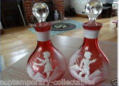A Beautiful pair of Cranberry Glass Decanters by Mary Gregory