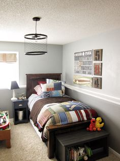 Ideas for big boys room. Lots of likeables in this space; light fixture, pallet artwork, night stand, patchwork bedding