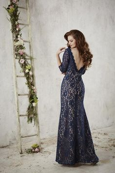 Christina Wu Celebration long lace gown with 3/4 length sleeves and low v-back is a great dress for bridesmaids and mother of the wedding. Available in many color combinations in sizes 0-36