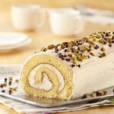 Inspired by a classic Italian dessert, vanilla sponge cake is frosted with amaretto ricotta frosting and is topped with pistachios and chocolate chips.