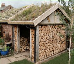 A green roofed log shed near Penrith. This roof is planted with wild flower and grass plugs in 2008 and the growing media is deep crushed building mixed with coir potting compost. The photo was taken one year after planting. Garden Buildings, Garden Structures, Casas Cordwood, Outdoor Firewood Rack, Firewood Holder, Firewood Storage, Stacking Firewood, Log Shed, Cordwood Homes