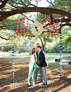 Colorful pom pom wedding backdrop