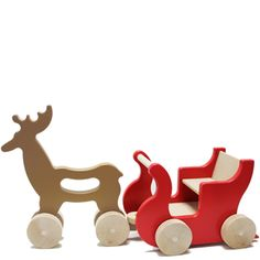 Part decoration for Christmas, part toy, and absolutely adorable! Reindeer and sleigh by Manny and Simon