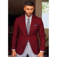 Maroon blazer, grey tie, white striped shirt, grey pants