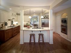 Kitchen Island Pendant Lighting | ... kitchen features an island with two paneled posts and pendant lighting