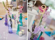 Purple and aqua wedding centerpieces with hurricane lantern and gold glitter table numbers.