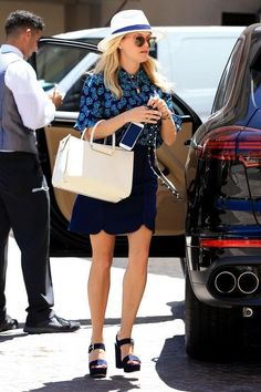 Reese Witherspoon wearing the Row Satchel 12 Tote Bag, Draper James Margaret Solid Skirt, Draper James St. Simons Fedora, Bandolier Sarah Black Leather & Gold Phone Case, Draper James Roxanne Button Down Shirt and Gianvito Rossi Gina Sandals
