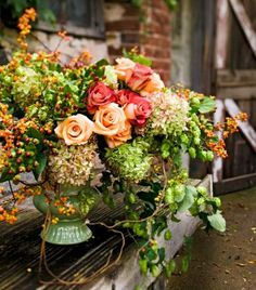 Roses and hydrangeas make a stunning fall arrangement. More ideas for decorating with hydrangeas: http://www.midwestliving.com/homes/seasonal-decorating/fall-decorating-with-hydrangeas/