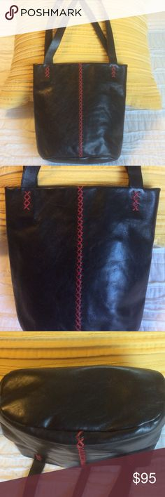 "EUC Johnny Farah New York Black Leather Bag Bucket style black soft leather bag by Johnny Farah New York with red crisscross stitching on the front,  back and straps. There is one zip pocket inside. Measurements 9""H x 10""W. Johnny Farah New York Bags Shoulder Bags"