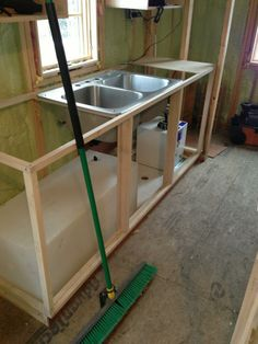 Sink, HW heater, and H20 Tank installed from Building the Tiny House on facebook  http://www.precisiontemp.com/cabins-and-small-homes/rv-550-nsp-tankless-water-heater-for-cabins-and-small-homes/