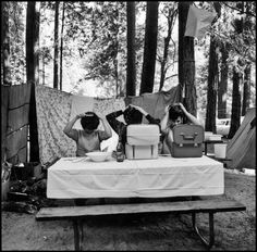 three women fixing their hair while camping at yosemite national park, 1965.