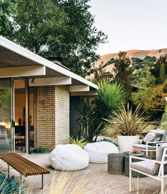 Modern Furniture Fit for a Classic Eichler In the backyard of this Eichler home in San Rafael, California, a pair of whitebeanbag chairs, outdoor sofa, and chairs were sourced from West Elm and the Case Study Museum Bench is from Modernica. Photo by:Drew Kelly