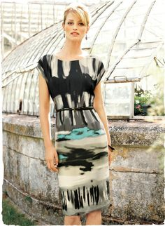 Graphic brushstrokes form abstract color fields in a sophisticated urban palette of graphite, lead and cream splashed with turquoise. Printed on hammered matte satin, this eye-catching sheath has an eased top with cap sleeves and a slim, straight skirt with back vent; fully lined.