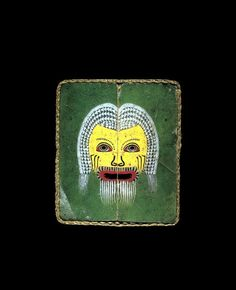 Roman glass plaque with actor's mask, 25 B.C.-75 A.D. Troupes of actors presented performances in major towns throughout Egypt. Some of the most popular characters appeared in the comedies of the Athenian playwright Menander. The actors employed conventionalized masks to represent these characters and the distinctive colors and features of the masks made them instantly recognizable, 2.8 cm by 2.4 cm. Corning museum of glass