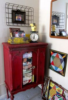 Refinish an old radio cabinet with milk paint to create a chippy look.