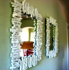 How awesome! Just some mirrors, glue, pieces of wood, & paint!