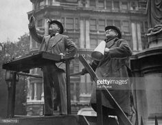 Sir Henry Wood (1869 - 1944, left) conducting a concert for ENSA (Entertainments National Service Association) outside St Paul's Cathedral, London, 25th September 1942. With him is the head of ENSA, English actor, writer, director and producer of stage and screen, Basil Dean (1888 - 1978).