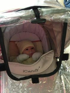 Baby Harper ready for a walk in the rain! Thank you to Natalie Strickland for sharing this lovely photo with us!