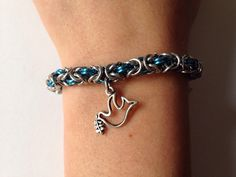 A personal favorite from my Etsy shop https://www.etsy.com/listing/225006101/blue-peace-dove-chainmaille-bracelet