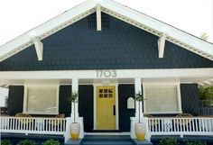 Steel-blue wood, crisp white trim and a yellow door that just pops. Via Young House Love. But switch blue to trim and white to house color? House Paint Exterior, Exterior Paint Colors, Exterior House Colors, Paint Colors For Home, Exterior Design, Grey Exterior, Bungalow Exterior, Paint Colours, Bungalow Renovation