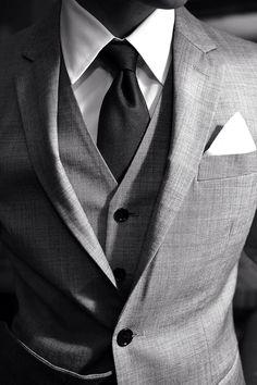 mens street style fashion: 3 piece grey suit vest waistcoat, jacket white pocket square black tie crisp white shirt (mw)