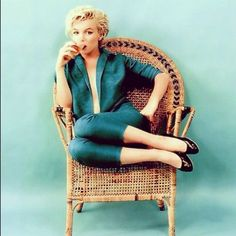 Marilyn Monroe blue wall and wicker chair