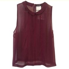 Topshop wine sleeveless chiffon top with collar This NWT sleeveless top is made of sheer chiffon and has a Peter Pan collar. The back fastens with one button at the neck. U.S. size 12. Topshop Tops Tank Tops