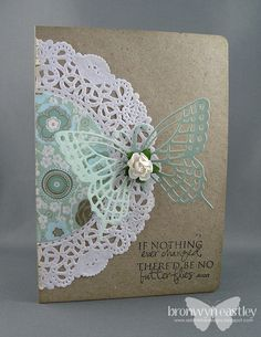 I love the added patterned paper to the doilies. Wonderful butterfly by Phalaina