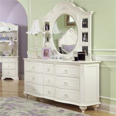 The Eleanor 9 Drawer Dresser is a wonderful storage option for you little princesses bedroom.  This dresser features nine drawers and Victorian Styling with flower bouquet details