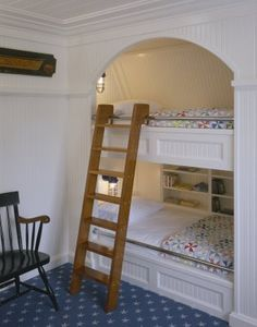 This is from a pool house on Cape Cod, but built-in bunks are great around here when lots of people come to ski. Love that sliding ladder.