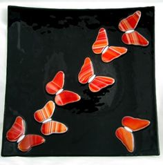 Butterflies Flying on Black Fused Glass Plate. $80.00, via Etsy.