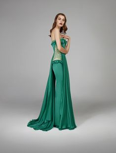 #GreenEnvy #luxurious #green #chiffon #gown #bombshell #silhouette #pleated #fabric #soft #little #ruffles #trimmed #French #lace #sweetheart #cleavage #flattering #curve #illusion #decadent #figure #fitted #mermaid #glamorous #fashion #design #autumnwinter #2018 #eveningwear #hamdaalfahim