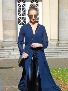 SHADES OF K by Karen   How to style Vinyl Pants. Wearing black vinyl pants, dark blue maxi dress, black embroidered ankle boots in western style, mirrored sunglasses, stacked bracelets, and oversized hoop earrings. Autumn Style,Street style, Isabel Marant vibes