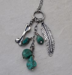 A personal favorite from my Etsy shop https://www.etsy.com/listing/228036619/sterling-silver-feather-brass-arrowhead