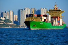 Colorful container ship pulling into Hong Kong Harbor.