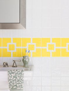 How to Brighten Up a Bland Bathroom: Spruce up your bathroom tile with a painted colorful geometric design