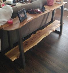 These sofa/entry tables can be made to your liking (one shelf or two shelves). The wood can be made from: walnut, rock elm, or cherry wood. We can even do aged barn wood! Pricing depends on the height and if you want one or two shelves. Each slab is 10-12 wide and 1.5-2 thick -walnut is