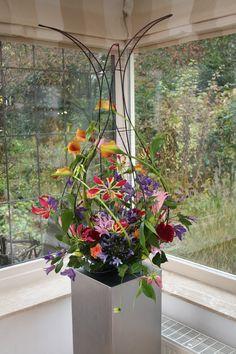 """Flowerarrangement designed and made by """"De Bloemendames"""" ."""