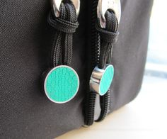 A more 'mature' zipper pull for your older kids, they can make themselves with Sugru clay and paracord.