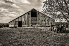 Old Barn and Tractor in SW Iowa I found. It was telling me a story about how at one time they were probably used daily...