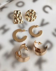 Funky gold earrings by TheHexad. From top to bottom: Mismatch Hammered Earrings, Horseshoe Bend Hoops and Contortionist Earrings. Shop these designs at www.thehexad.com