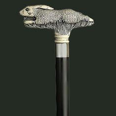 Italy. Faux antique scrimshaw   resin Running Rabbit handle.   Stainless collar. Black hard wood