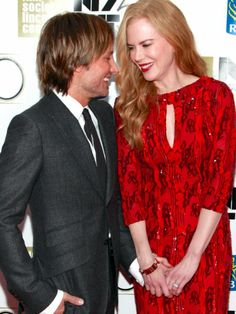 Nicole & Keith: Tender Moment  Lady in red! Nicole Kidman and husband Keith Urban share a laugh as they arrive at the New York Film Festival on Oct. 3