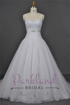 http://www.parklandbridal.co.nz/Store/tabid/4393/ProdID/33792/CatID/358/Parkland_Bridal_Helen.aspx  A beautiful dropped waist organza gown. Simple and stunning! Features a ruched bodice and satin sash with luxury beading. DIVINE and amazing value!