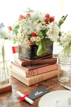 Books,  glass, vintage tins and flowers.