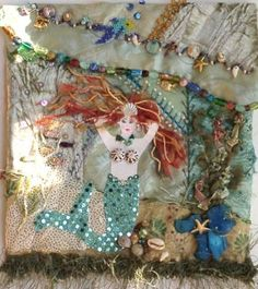 Seascape. Crazy quilt possibilities. Mermaid, shells, seaweed.  C'mon, not all mermaids have red hair.