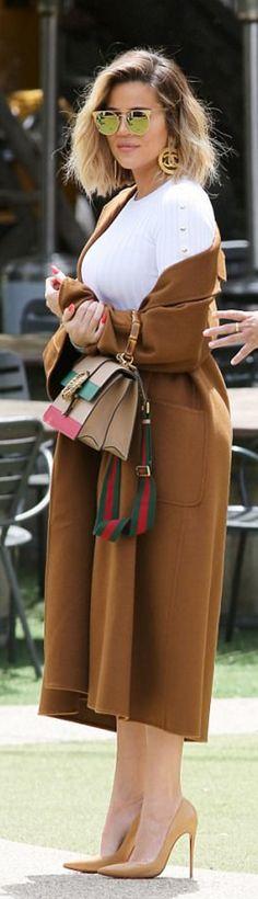 Who made  Khloe Kardashian's gold jewelry, white ribbed dress, tan pumps, green striped handbag, and nude pumps?