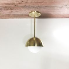 Brass Stem Butter Sconce with opal -or clear glass Constructed with solid brass, hand brushed and waxed finish. Shown in clear and brass with 12 rod Dimensions: Custom Lighting, Brass Material, Globe Lights, Raw Materials, Solid Brass, Canopy, Clear Glass, Sconces, Industrial